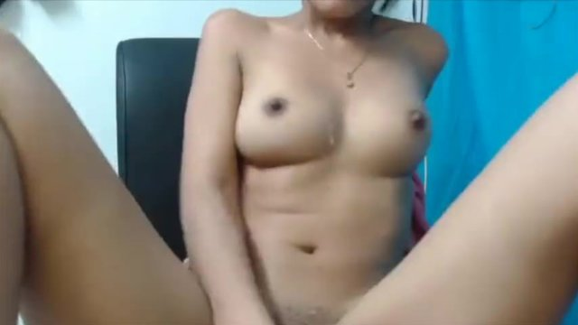 Cute Latina fucks herself and pees in a bowl